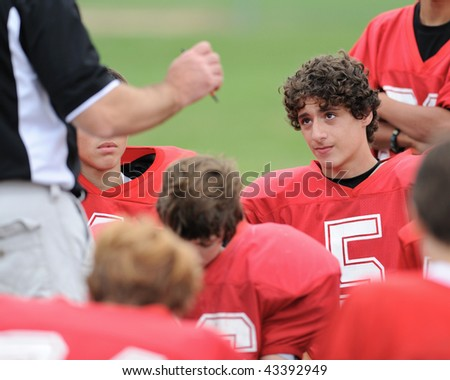 Football player in huddle - stock photo