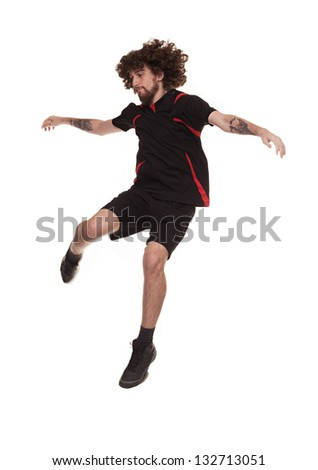 football player in the air ready to kick the ball isolated on white background - stock photo