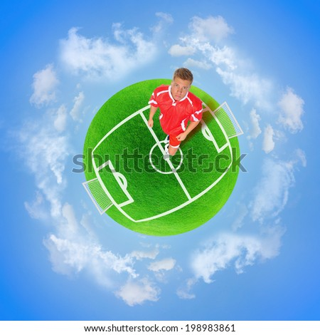 Football player in the red form on planet football Soccer stadium