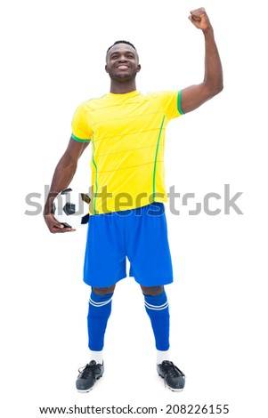 Football player in yellow celebrating a win on white background