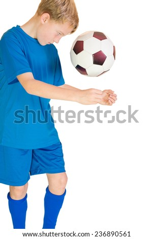 Football player makes header - stock photo