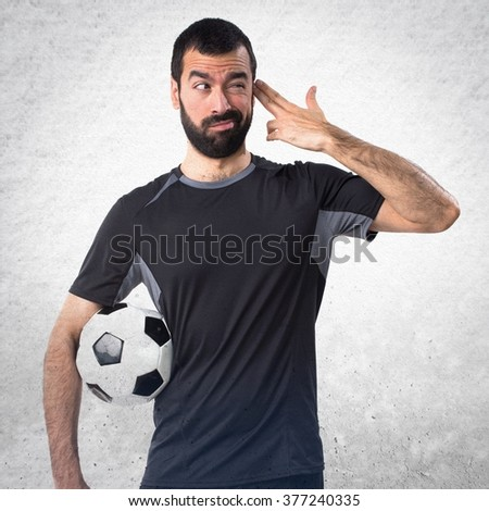 Football player making suicide gesture over textured background