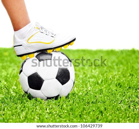 Football player, men foot on the ball, playing sport game at outdoor stadium, green grass field, isolated on white with text space, conceptual image of competition, goal and healthy active lifestyle - stock photo