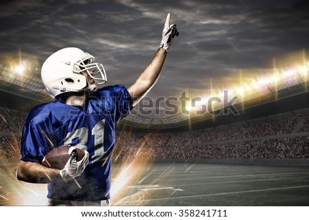 Football Player on a Blue uniform celebrating on a Stadium.