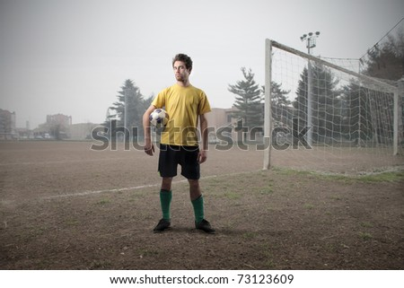 Football player on a football court - stock photo