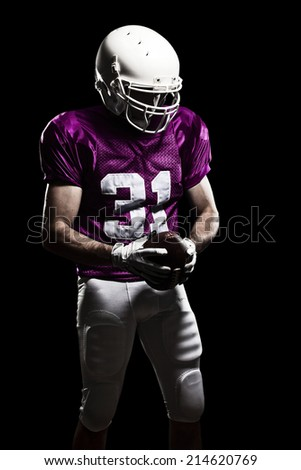 Football Player on a pink uniform, on a black background.