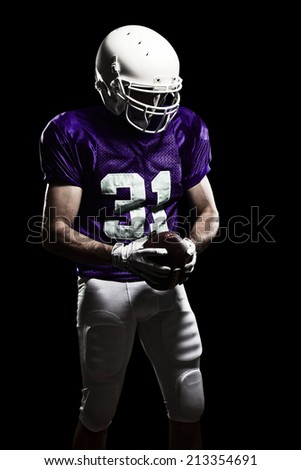 Football Player on a purple uniform, on a black background.