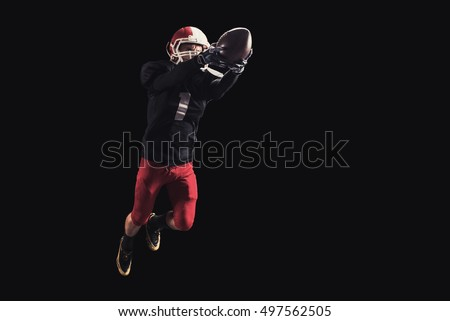 Football player on dark background