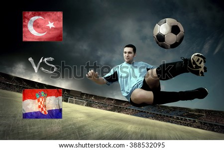 Football player on soccer field of stadium. Match between two countries.