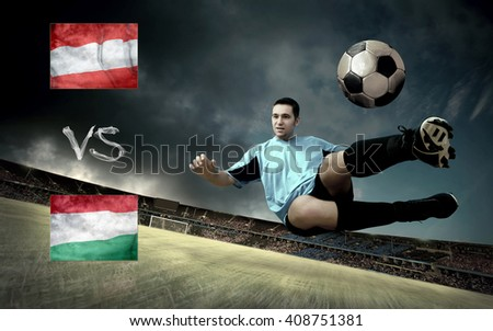 Football player on soccer field of stadium. Match between two national teams. - stock photo
