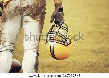 Football player on the field - retro styled photo - stock photo