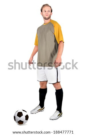 Football player readying for a free kick isolated in white - stock photo