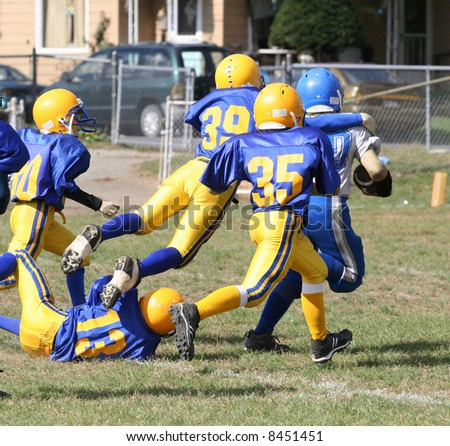 Football Player Running for the Touchdown - stock photo