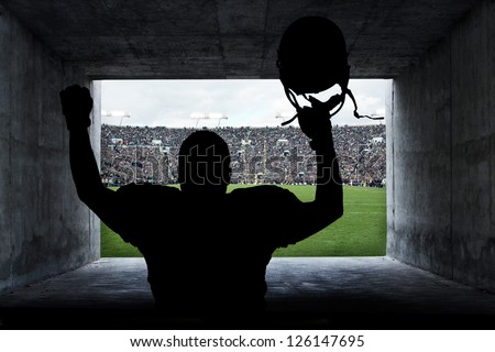Football Player running out of the Stadium Tunnel - stock photo