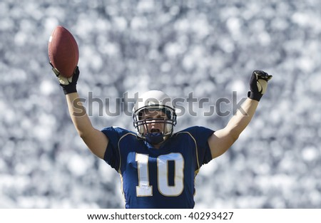 Football Player Scoring a Touchdown - stock photo