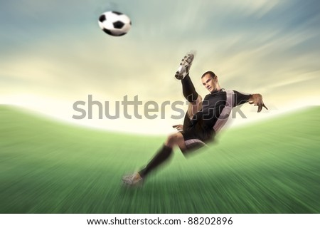 Football player shooting a football - stock photo