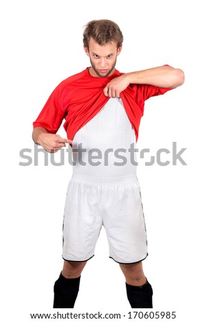 Football player showing under shirt where you can place your text - stock photo