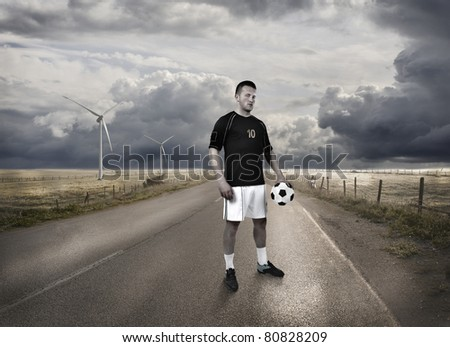 Football player standing on the road