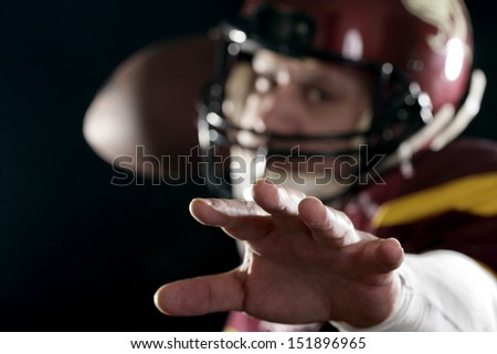 Football player throwing a hit