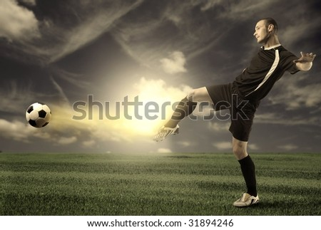 football player training in a grass field - stock photo