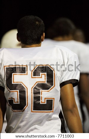 Football player walking off field - stock photo