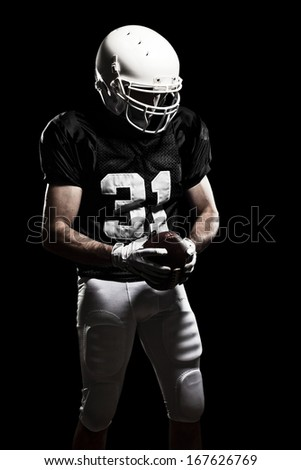 Football Player with a black uniform, on a black background.