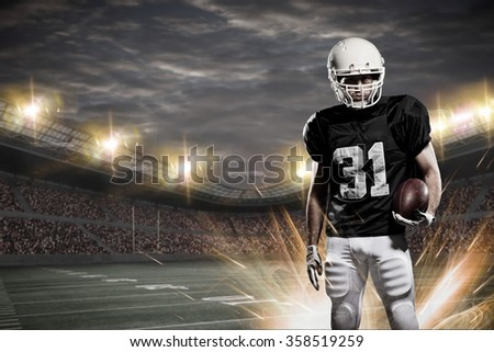 Football Player with a black uniform on a stadium.
