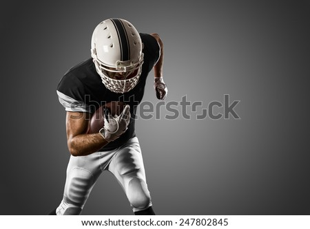 Football Player with a black uniform Running on a black background.