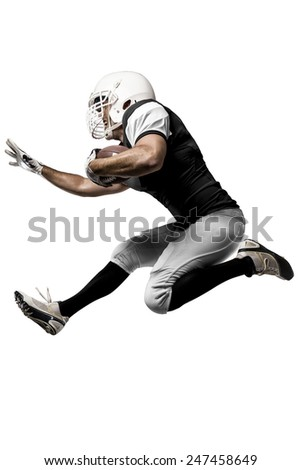 Football Player with a black uniform Running on a white background. - stock photo