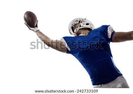 Football Player with a blue uniform making a catching on a white background. - stock photo