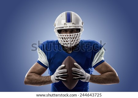 Football Player with a blue uniform on a blue background. - stock photo