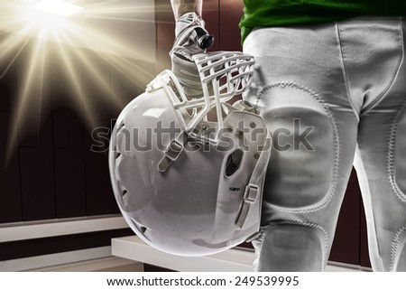 Football Player with a green uniform on a Locker roon. - stock photo