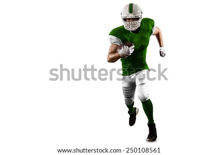 Football Player with a Green uniform Running on a white background. - stock photo
