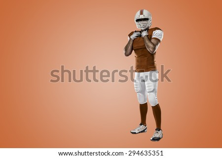 Football Player with a orange uniform on a orange background.