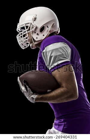 Football Player with a purple uniform Running on a black background.
