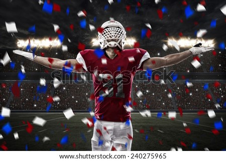 Football Player with a red uniform celebrating, on a stadium. - stock photo