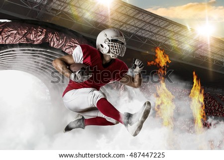 Football Player with a red uniform coming out of a stadium tunnel.