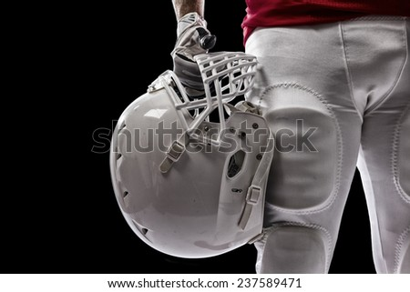 Football Player with a red uniform on a Black background. - stock photo