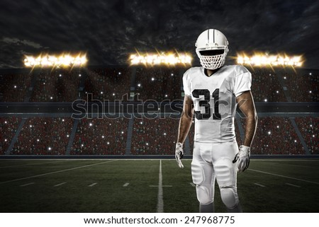 Football Player with a white uniform on a stadium. - stock photo