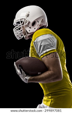 Football Player with a yellow uniform Running on a black background.