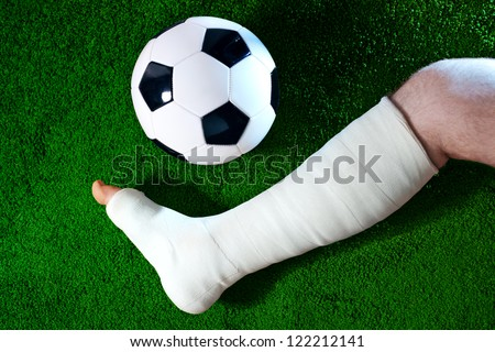 Football player with broken leg. - stock photo