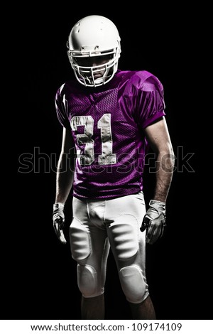 Football Player with number on the pink uniform. - stock photo