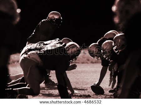 Football players are ready to start. - stock photo