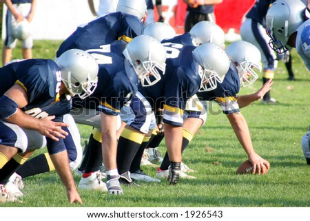 football players, offense – defense in action - stock photo