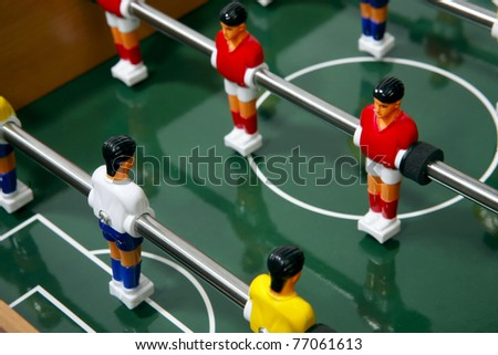 Football  players on the grass field background. Board game. - stock photo