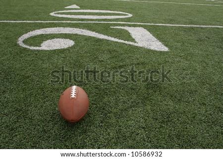 Football positioned near the twenty yardline - stock photo