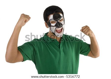 Football's fan with hands up and painted ball on face. He's on white background. Front view. He's looking at camera. - stock photo