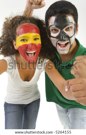 Football's fans with painted faces. They're looking at camera. Front view. - stock photo