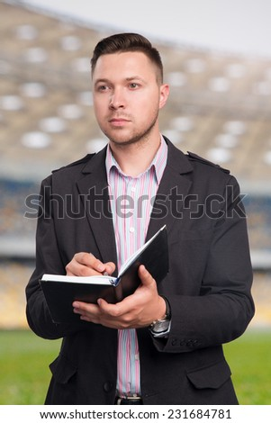 Football scout at work - stock photo