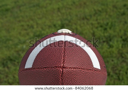 Football sitting on a green grass background